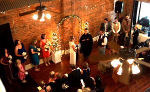 Full view of large wedding with bridesmaids, groom's men and guests